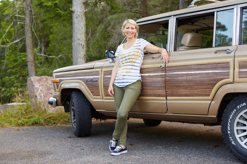 samantha brown standing in front of station wagon