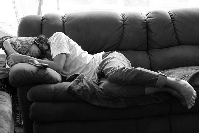 man sleeping in sofa