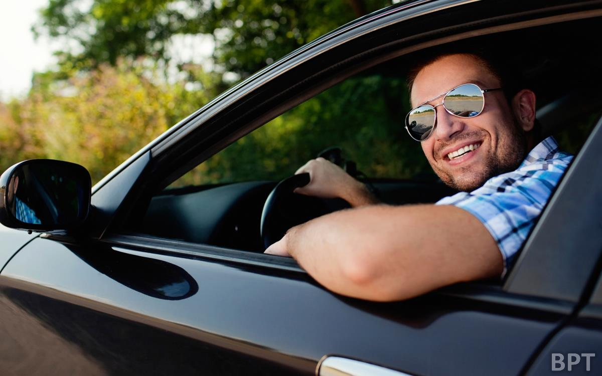 Man hanging out of car window