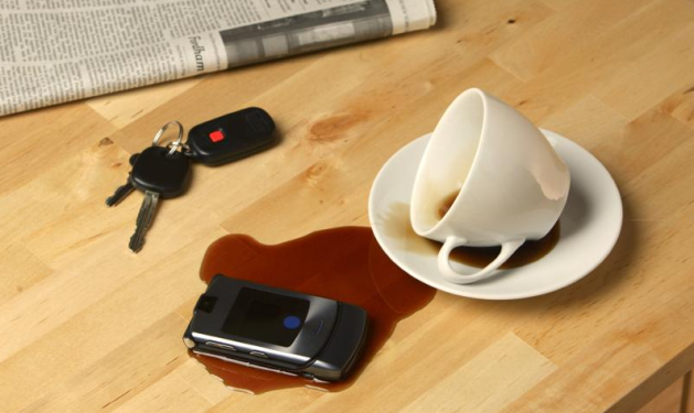 Phone covered in coffee