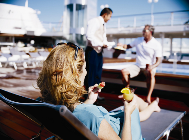 Woman and man being served on deck of cruise ship