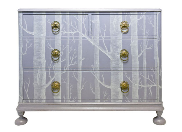 Dresser covered in tree motif wallpaper