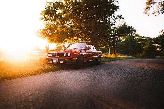 1990 Red BMW 325i on roadside