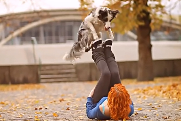 Woman doing tricks with her dog
