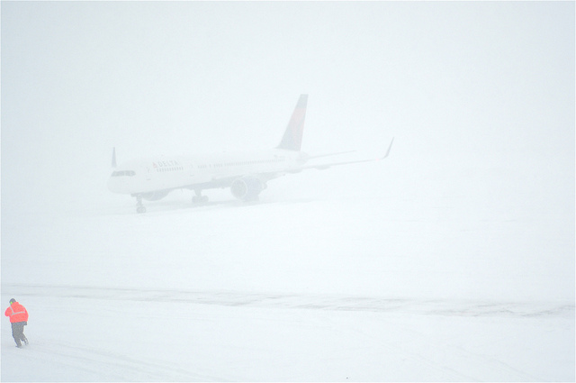 plane at airport in a blizzard and snow