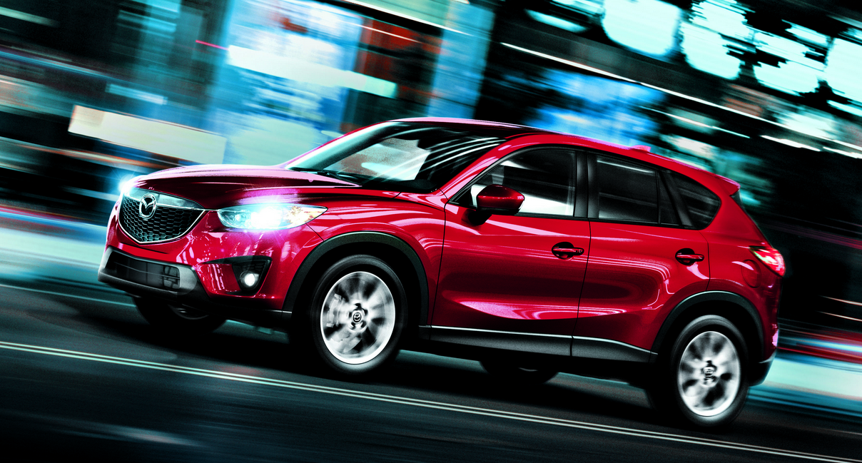 red mazda cx-5 on road
