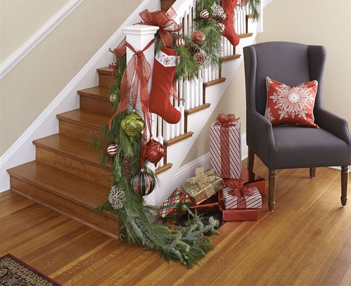 stair banister decorated for christmas