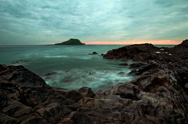 Rocky bay with muted colors at sunset
