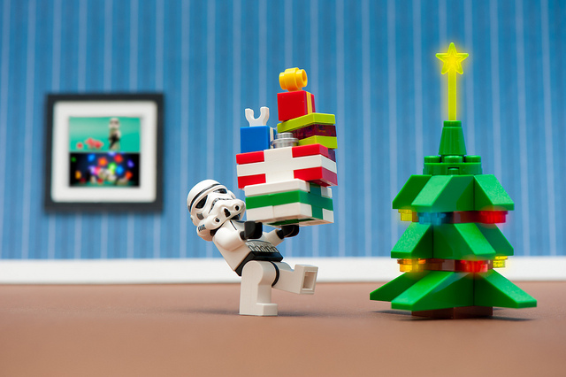 lego storm trooper carrying presents to the christmas tree