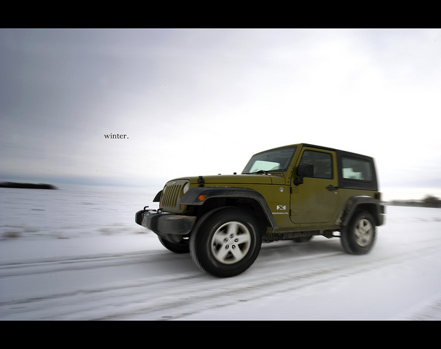 jeep driving on snowy road
