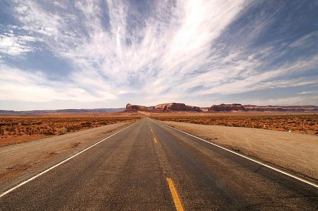 open desert road on road trip