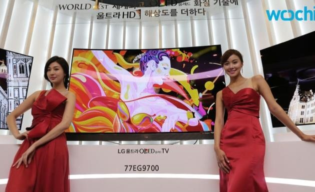 lg displaying tv with two models