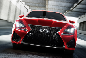 red lexus driving on a road front view
