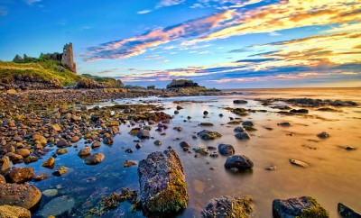 Dunure Castle next to a Scottish lake in Scotland