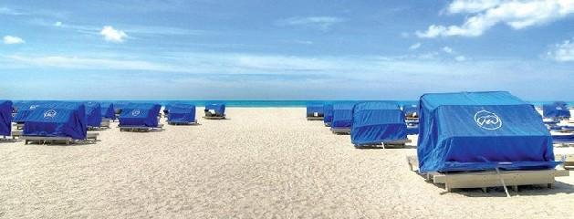 st. pete beach with beach chairs