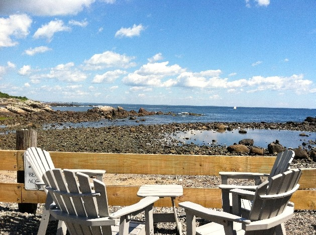 deck chairs overlooking rocky shoreline