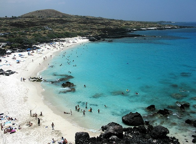 white sand and rocky beach with people