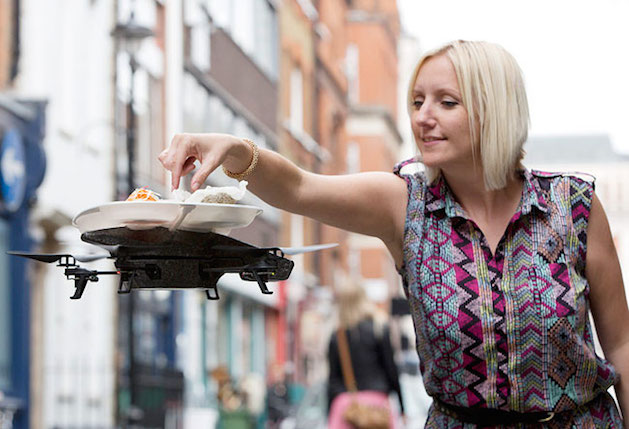 Drone serving food to a woman