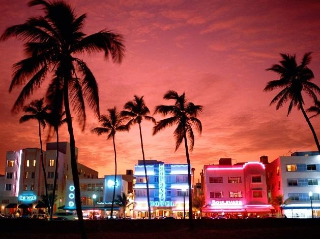 south beach bars lit up at night