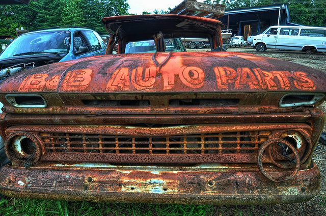 old rusted truck in salvage yard