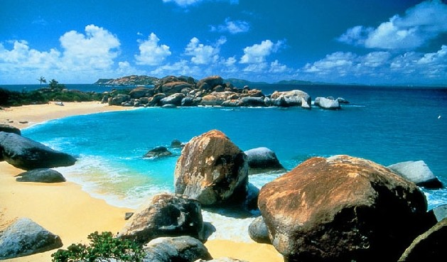 rocky beach shore with crystal blue water