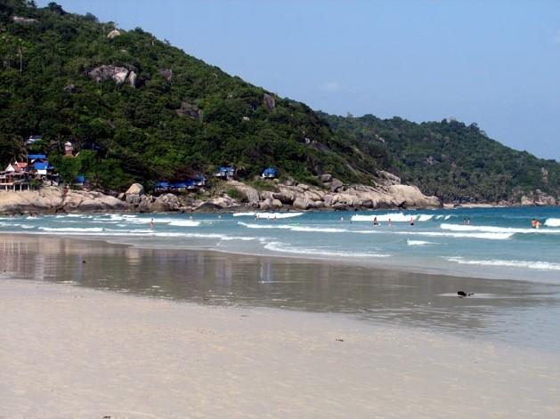 beach with rocky cliffs in background