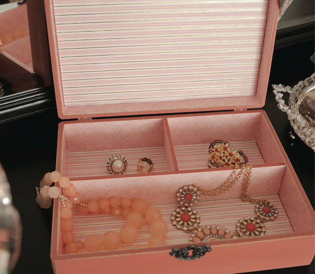 pink jewelry box with jewelry