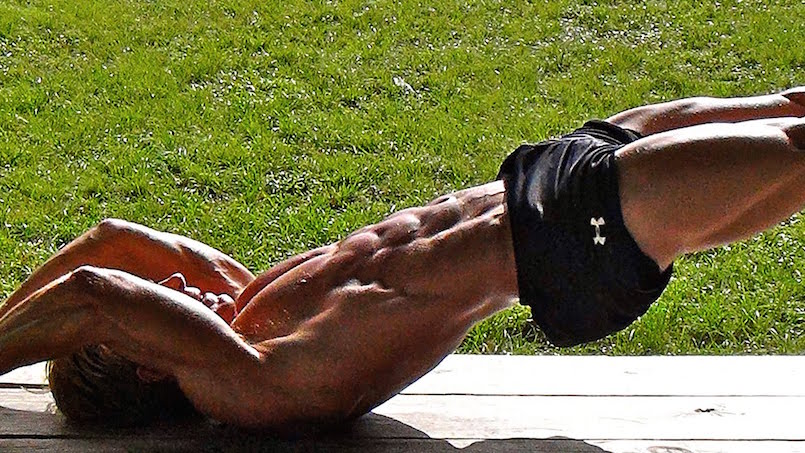 man with tight abs doing ab workout