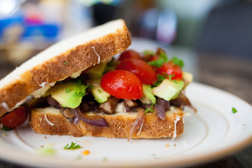 vegetarian sandwich with tomatoes avacado and onions