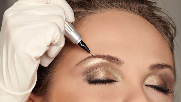 woman getting permanent makeup