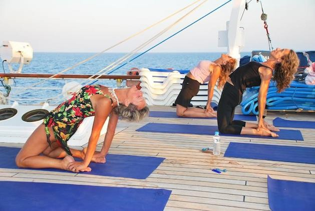 women doing yoga on a sail boat
