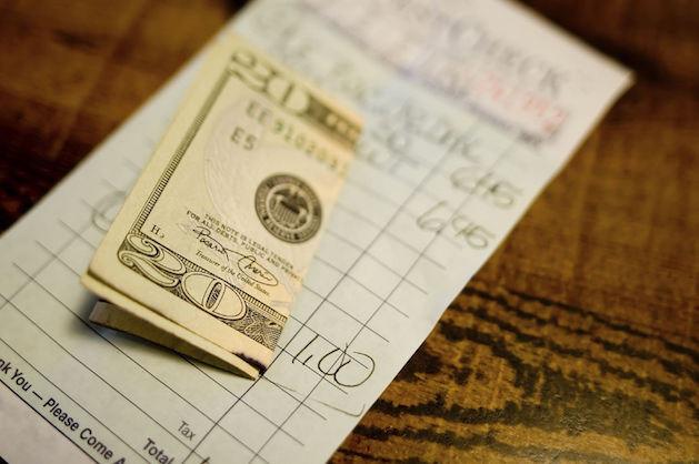 $20 bill on restaurant check