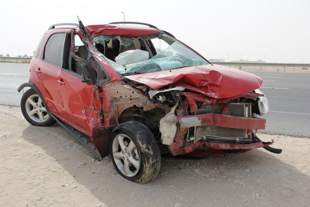 Red Suzuki front end wrecked