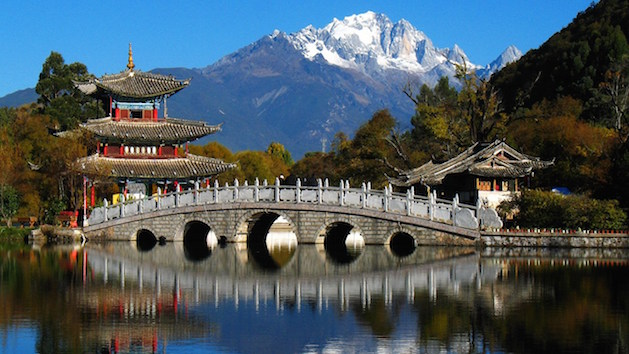 chinese bridge with mountains in background