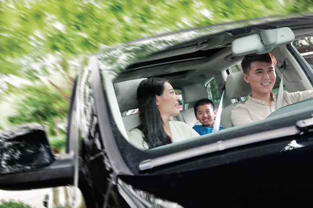 family in black car