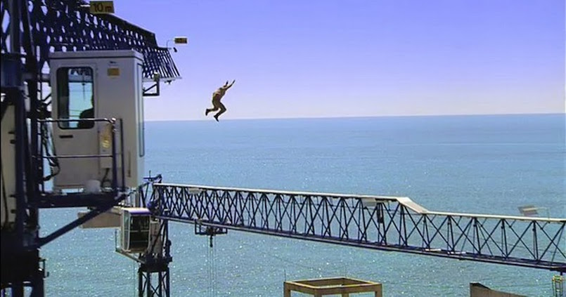 man jumping from crane