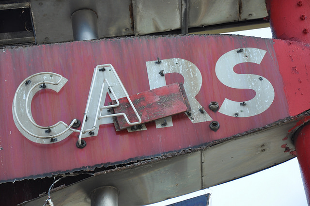 old sign that says Cars