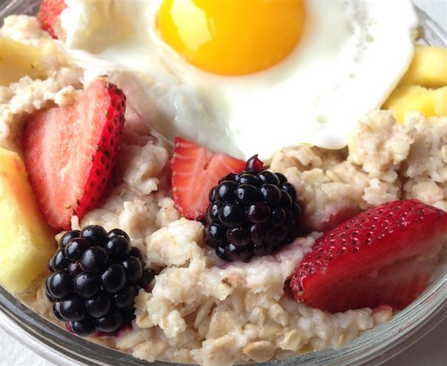 berries and egg over oatmeal