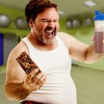 fat man with protein shake and protein bar