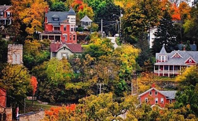 old houses on hillside with trees