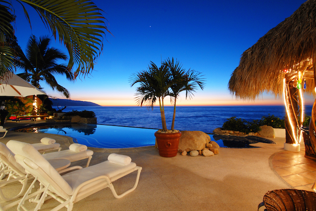 tropical patio with infiniti pool overlooking the ocean