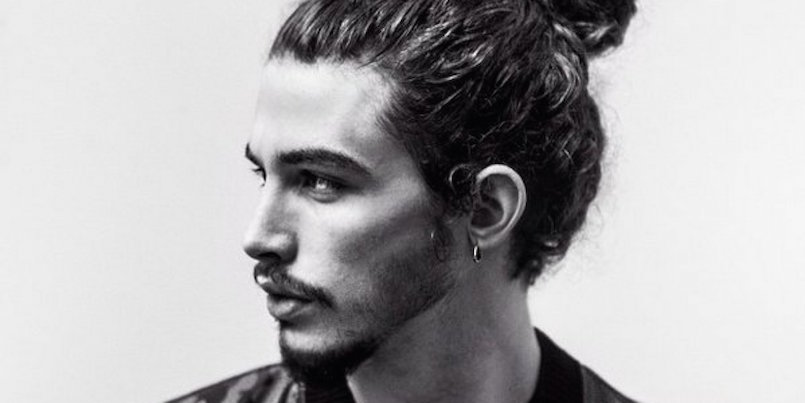 black and white photo of a guy with a man bun