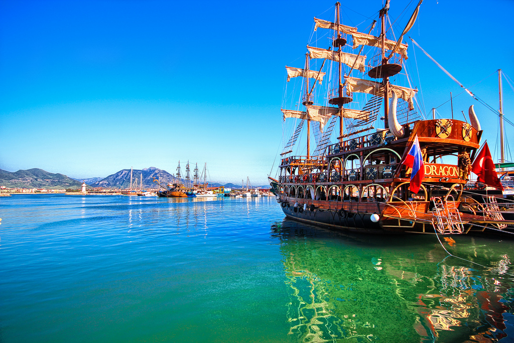 Pirate ship on bright blue and green water
