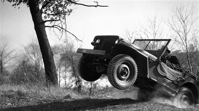 jeep flying through the mud