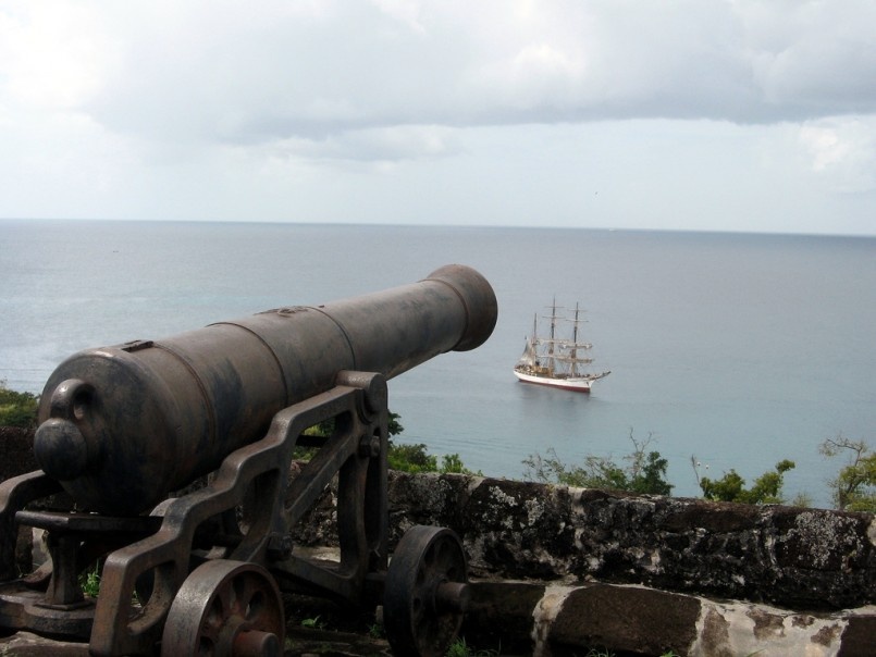 cannon aiming at pirate ship on the sea