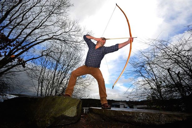 man with bow and arrow