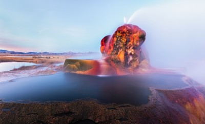 Fly Geyser near the Black Rock Desert in Nevada constantly erupts minerals and hot water creating bright colors and terraced pools