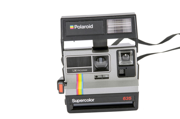 MOSCOW, RUSSIA - FEBRUARY 02, 2015- Polaroid Supercolor 635 plastic camera for instant photos from the year 1980-1990