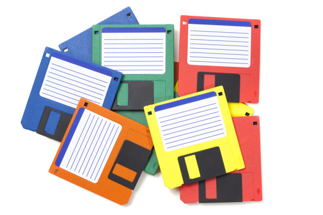 Set of floppy disks in 3.5 inch format with 1.44 MB capacity as commonly used in the late 80s:early 90s as storage medium for computer data. Studio shot, isolated on white background.
