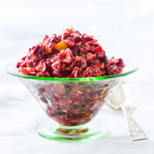 Cranberry orange relish in glass bowl with spoon